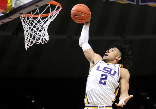 LSU forward Trendon Watford (2) dunks during first half action against Bowling Green during an NCAA college basketball game in Baton Rouge, La. Friday, Nov. 8, 2019. (AP Photo/Brett Duke)