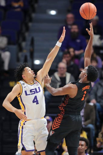 Bowling Green guard Justin Turner (1) shoots in front of LSU guard Skylar Mays (4) in the first half of an NCAA college basketball game in Baton Rouge, La., Friday, Nov. 8, 2019. (AP Photo/Brett Duke)