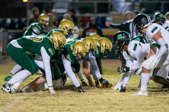 Acadiana High's offensive line goes up against the opposing defensive line as the Acadiana High Wreckin' Rams take on the Lafayette High Mighty Lions on Senior Night, Thursday, Nov. 8, 2019.