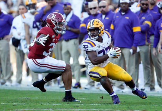 Nov 9, 2019; Tuscaloosa, AL, USA; LSU Tigers running back Clyde Edwards-Helaire (22) runs the ball against Alabama Crimson Tide linebacker Markail Benton (36) during the first half at Bryant-Denny Stadium. Mandatory Credit: Butch Dill-USA TODAY Sports
