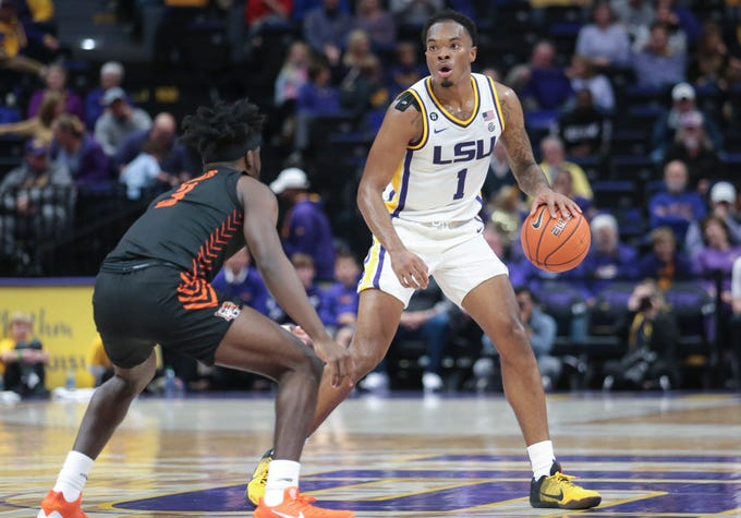 LSU guard Javonte Smart (1) works to get around Bowling Green guard Caleb Fields (3) in the first half of an NCAA college basketball game in Baton Rouge, La., Friday, Nov. 8, 2019. (AP Photo/Brett Duke)