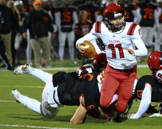 Brighton's Luke Stanton sacks East Kentwood quarterback Christian Tanner in the Bulldogs' 48-26 playoff victory on Friday, Nov. 8, 2019.