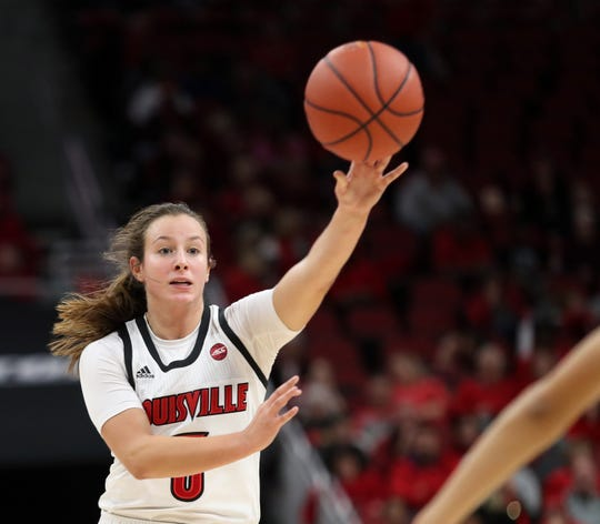 Louisville's Seygan Robins passes the ball up court against Murray State on Nov. 8, 2019.