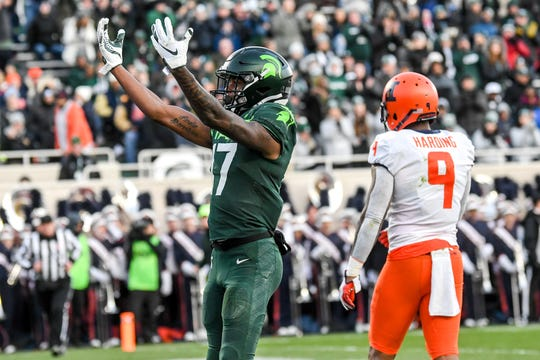Michigan State's Tre Mosley celebrates a touchdown during the second quarter on Saturday, Nov. 9, 2019, at Spartan Stadium in East Lansing.