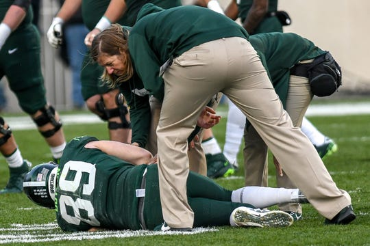 Michigan State's Matt Dotson is injured on a play during the first quarter on Saturday, Nov. 9, 2019, at Spartan Stadium in East Lansing.