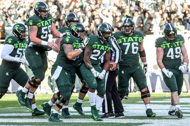 Michigan State's Elijah Collins fell just short of 1,000 yards rushing last season. Not since 2014 has MSU's produced a 1,000-yard rusher. That's largely been an offensive line issue.