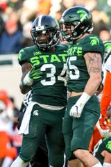 Michigan State's Antjuan Simmons, left, and Noah Harvey celebrate a stop during the first quarter on Saturday, Nov. 9, 2019, at Spartan Stadium in East Lansing.