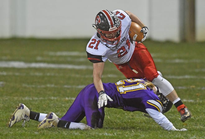 Crestview's Sage Baith is hit as he runs for a first down during a game with East Knox High School on Friday night.
