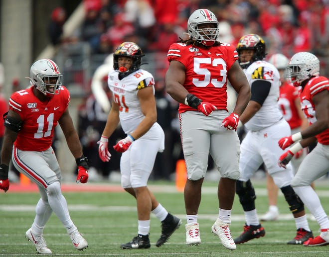 Ohio State defensive tackle Davon Hamilton reacts after the second of his two sacks in Saturday's 73-14 win over Maryland.