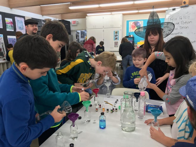 Kids flocked to the Harry Potter-themed class Saturday morning at the Mansfield Art Center to brew up potions. Instructor Emily Negro assisted kids with their concoctions.