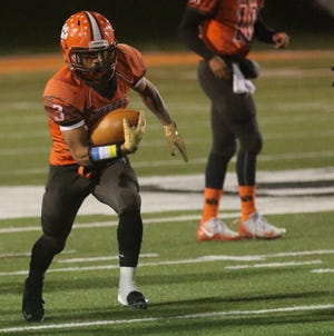 Mansfield Senior's Terrance Flickinger scored three touchdowns in the Tygers' 28-0 win over Bay last week.