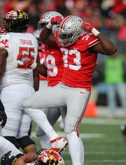 Ohio State freshman end Zach Harrison flexes (which drew a personal foul flag) after recording one of the Buckeyes' seven sacks in the 73-14 rout of Maryland