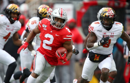 Ohio State running back J.K. Dobbins scores one of his two touchdowns in the 73-14 romp past Maryland.