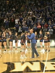 Gena West, a senior at HIghland, receives her Division II state runner-up medal Saturday at Wright State after the Scots lost 3-1 to Bishop Fenwick.