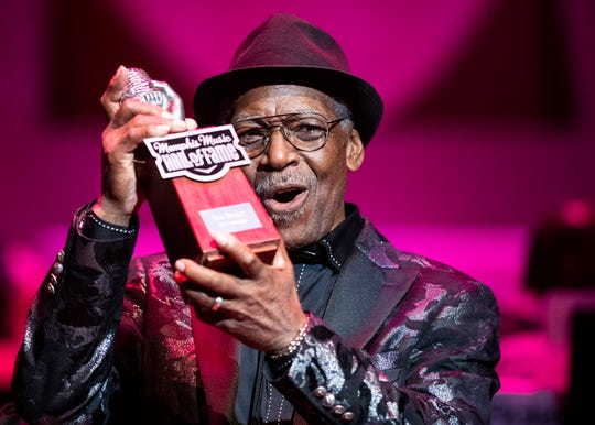 Rhythm and blues singer and songwriter Don Bryant accepts his award at the Memphis Music Hall of Fame induction at the Cannon Center for Performing Arts on Friday.