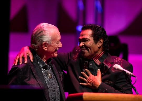 Grammy Award-winning American blues musician Bobby Rush and electric blues harmonica player Charles Douglas Musselwhite laugh together on stage at the Memphis Music Hall of Fame induction.