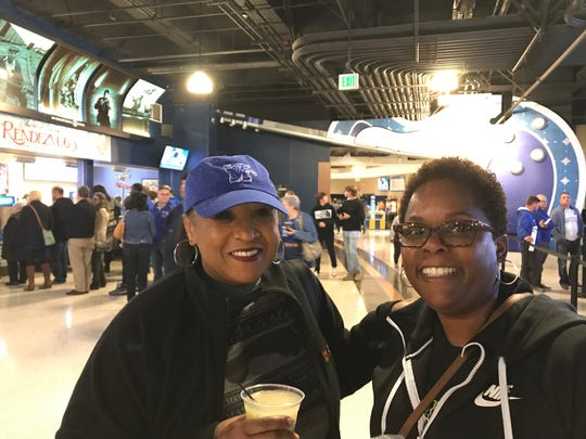 Cynthia Cross and Staffardnett Young pose for a photo while attending a Memphis Tigers Basketball game Friday, Nov. 8 at the FedExForum.