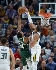 Bucks forward Giannis Antetokounmpo has his shot blocked by Jazz center Rudy Gobert, the reigning defensive player of the year in the NBA.