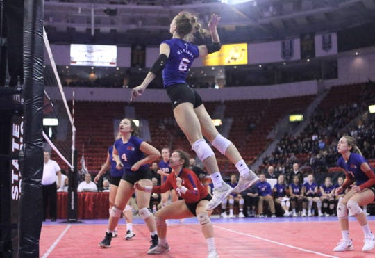 Wisconsin Lutheran hitter Julia Treichel goes up for a kill against Luxemburg-Casco during a WIAA state semifinal.