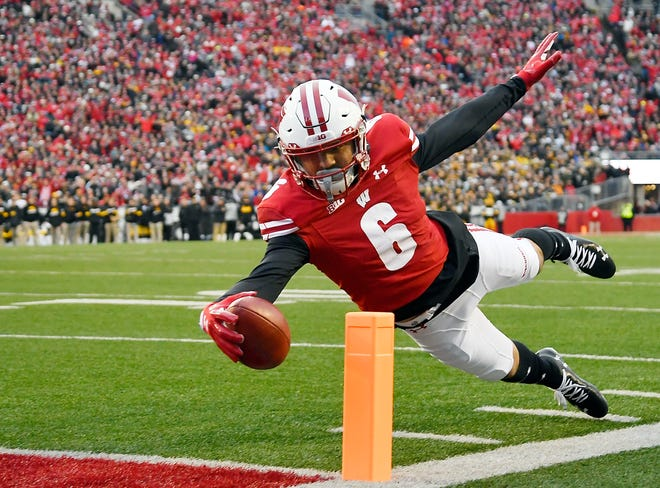 Danny Davis of the Wisconsin Badgers dives to score a touchdown in the first half against the Iowa Hawkeyes at Camp Randall Stadium Saturday.