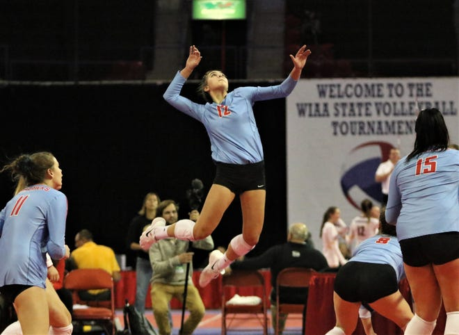 Arrowhead senior Aubrey Hamilton rises up for a kill against Burlington in a WIAA state semifinal.