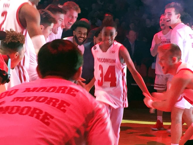 Jerrell Moore, son of Wisconsin assistant coach Howard Moore, is introduced with the Badgers starters Friday, November 8, 2019, before a game against Eastern Illinois at the Kohl Center.