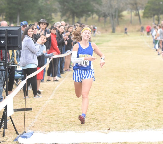 Mountain Home's Marcie Cudworth crosses the finish line during the recent 5A-East Conference cross country meet. Cudworth won the Class 5A State individual championship on Saturday.