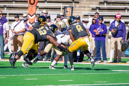 Grambling State defensive linemen Wesley Green (92) and Anfernee Mullins (8) bring down an Alcorn State runner during a SWAC game at Eddie G. Robinson Memorial Stadium Saturday, Nov. 9, 2019.