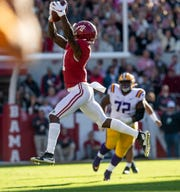 Alabama wide receiver Henry Ruggs, III, (11) catches a first down pass against LSU at Bryant-Denny Stadium in Tuscaloosa, Ala., on Saturday November 9, 2019.