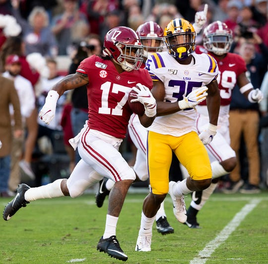 Alabama wide receiver Jaylen Waddle (17) scores on a kick return against LSU at Bryant-Denny Stadium in Tuscaloosa, Ala., on Saturday November 9, 2019.