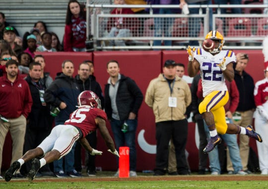 LSU running back Clyde Edwards-Helaire (22) catches a touchdown pass late in the first half at Bryant-Denny Stadium in Tuscaloosa, Ala., on Saturday, Nov. 9, 2019. LSU leads Alabama 33-13 at halftime.