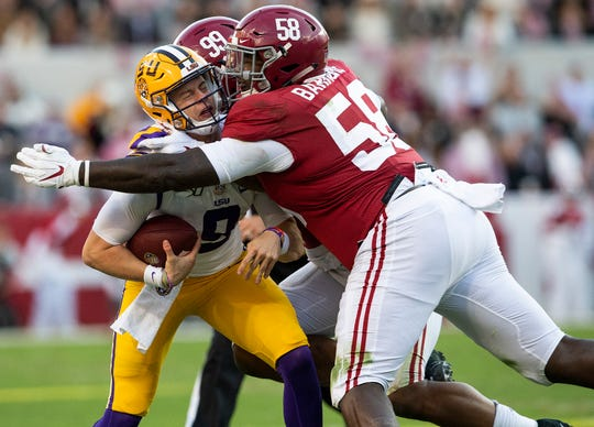 LSU quarterback Joe Burrow (9) is tackled by Alabama defensive linemen Raekwon Davis (99) and Christian Barmore (58) at Bryant-Denny Stadium in Tuscaloosa, Ala., on Saturday November 9, 2019.