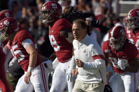 Nov 9, 2019; Tuscaloosa, AL, USA; Alabama Crimson Tide head coach Nick Saban runs onto the field before the start of their game against the LSU Tigers at Bryant-Denny Stadium. Mandatory Credit: John David Mercer-USA TODAY Sports