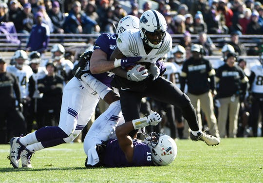 Nov 9, 2019; Evanston, IL, USA; Purdue Boilermakers wide receiver David Bell (3) runs as Northwestern Wildcats linebacker Paddy Fisher (42) tackles him during the first half at Ryan Field. Mandatory Credit: David Banks-USA TODAY Sports
