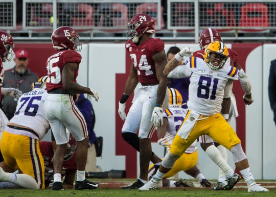 LSU tight end Thaddeus Moss (81) celebrates after LSU running back Clyde Edwards-Helaire (22) leaps into the end zone for a touchdown at Bryant-Denny Stadium in Tuscaloosa, Ala., on Saturday, Nov. 9, 2019. LSU leads Alabama 33-13 at halftime.