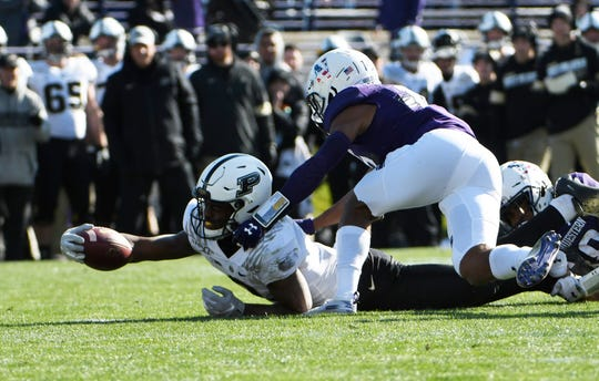 Nov 9, 2019; Evanston, IL, USA; Purdue Boilermakers wide receiver David Bell (3) stenches for yardage against the Northwestern Wildcats during the first half at Ryan Field. Mandatory Credit: David Banks-USA TODAY Sports