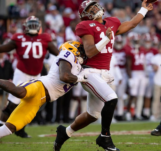 Alabama quarterback Tua Tagovailoa (13) is hit as he releases the ball by LSU safety Marcel Brooks (9) at Bryant-Denny Stadium in Tuscaloosa, Ala., on Saturday November 9, 2019.