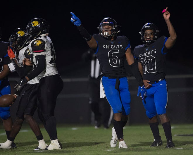 Catholic's TJ Dudley (6) and Catholic's Jalen Fountain (10) react after making a stop in the backfield at Montgomery Catholic High School in Montgomery, Ala., on Friday, Nov. 8, 2019. Montgomery Catholic leads Williamson 14-6 at halftime.