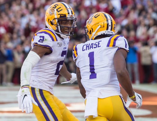 LSU wide receiver Justin Jefferson (2) and LSU wide receiver Ja'Marr Chase (1) celebrate Chase's touchdown catch at Bryant-Denny Stadium in Tuscaloosa, Ala., on Saturday, Nov. 9, 2019. LSU leads Alabama 33-13 at halftime.