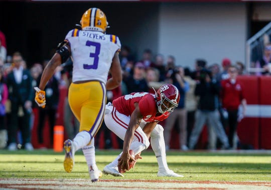 Nov 9, 2019; Tuscaloosa, AL, USA; Alabama Crimson Tide place kicker Ty Perine (99) drops the snap as LSU Tigers safety JaCoby Stevens (3) closes in during the first half at Bryant-Denny Stadium. Mandatory Credit: Butch Dill-USA TODAY Sports