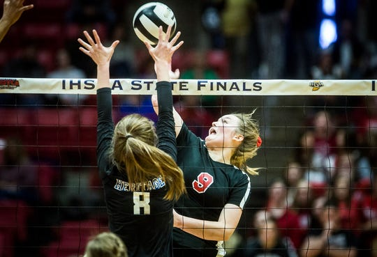 Wapahani's Mallory Summers hits against Heritage Christian's defense during their state final game at Worthen Arena Saturday, Nov. 9, 2019. Heritage Christian defeated Wapahani 3-0.