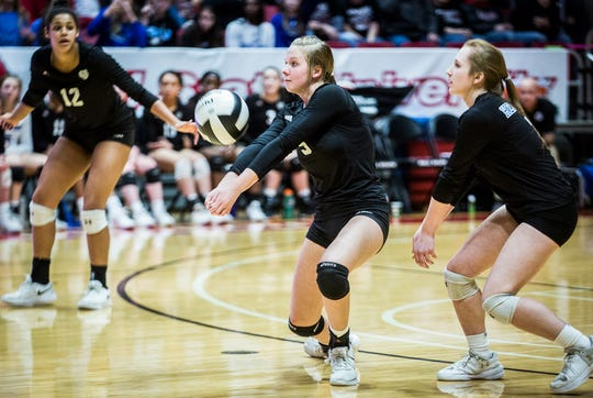 Heritage Christian's Abby Mennen passes against Wapahani's defense during their state final game at Worthen Arena Saturday, Nov. 9, 2019. Heritage Christian defeated Wapahani 3-0.