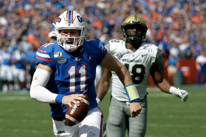 Florida quarterback Kyle Trask (11) runs past Vanderbilt linebacker Andre Mintze for a 9-yard touchdown Nov. 9.