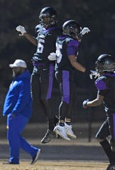 Cane Ridge wide receiver Adonai Mitchell (5) celebrates a touchdown with running back Reginald Goodloe (25) in the Tennessee 6A playoffs in November 2019 in Nashville, Tennessee.