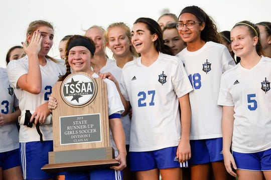 Nolensville holds theur trophy after their loss to Greeneville in the Class AA soccer final at Page High School in Franklin, Tenn., Saturday, Nov. 9, 2019.