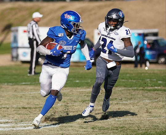 Tennessee State receiver Steven Newbold tries to elude Eastern Illinois' Mark Williams in Saturday's final home game at Hale Stadium.