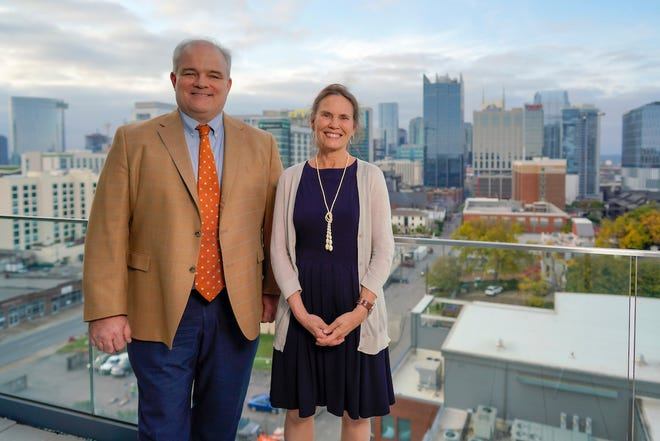 Bob Higgins, left, CEO of Barge Design Solutions, and Linda Marzialo, CEO of Gould Turner Group, announced the merger of their companies.