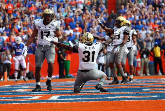 Vanderbilt Commodores defensive back Cam Watkins (31) celebrates as he breaks up a pass in the end zone against the Florida Gators during the first quarter at Ben Hill Griffin Stadium.