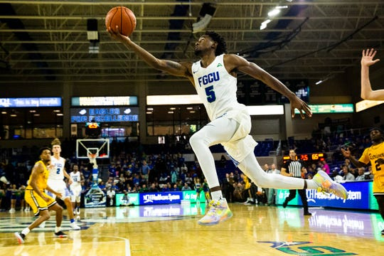 The Florida Gulf Coast University's Jalen Warren shoots a layup during FGCU's 2019-20 home season against UMBC on Saturday, November 9, 2019, at Alico Arena.