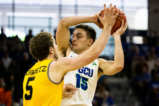 The Florida Gulf Coast University's Sam Gagliardi attempts to pass the ball through Jack Schwietz's defense during FGCU's 2019-20 home season against UMBC on Saturday, November 9, 2019, at Alico Arena.